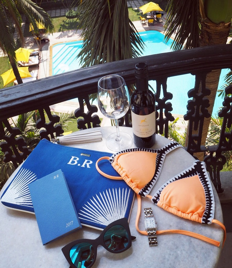 Flatlay oberoi grand hotel style traveller