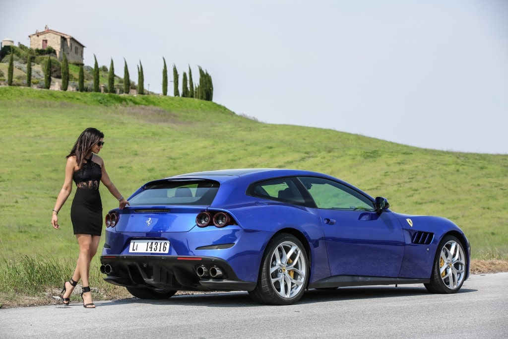 girl driving Ferrari tuscany fields