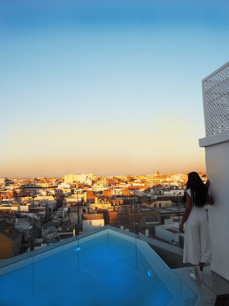 bonnie rakhit style traveller in gran melia colon hotel seville rooftop pool