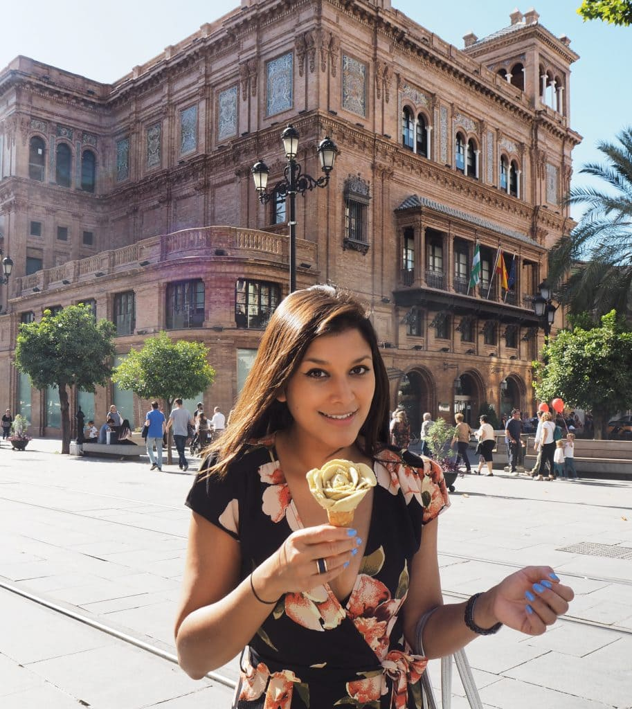 Bonnie Rakhit travel blogger in seville with floral icecream