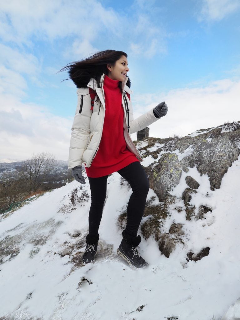 girl mountain climbing snow