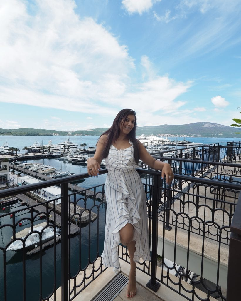Bonnie Rakhit Style Traveller at Regent porto Montenegro luxury balcony