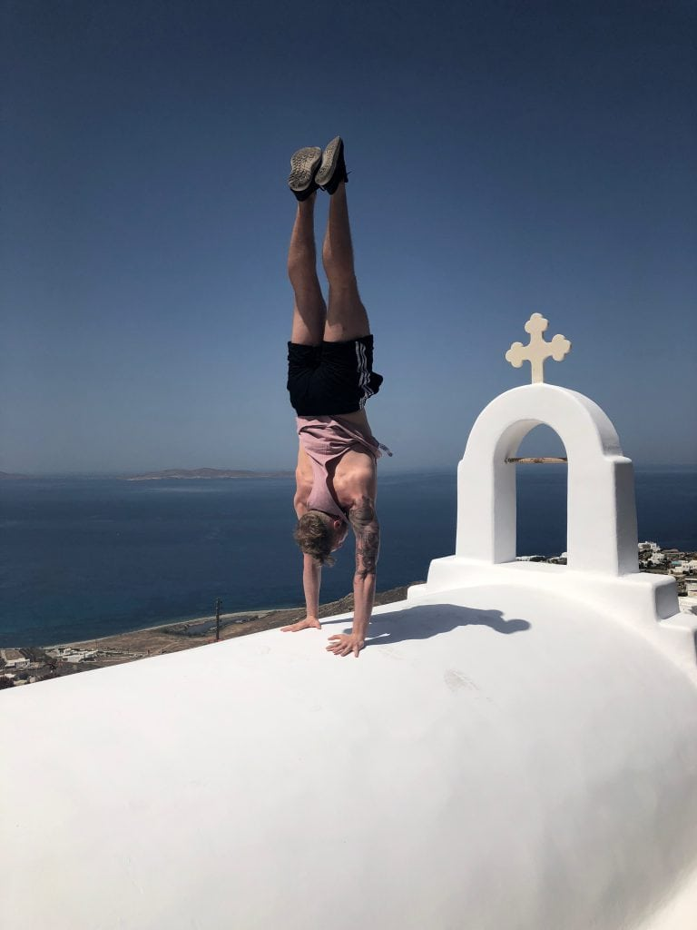 Charlie Van den berg perfects his handstand at Helios retreats