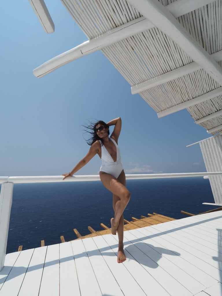Bonnie Rakhit TRX straps on Helios best europe Fitness Retreats Mykonos