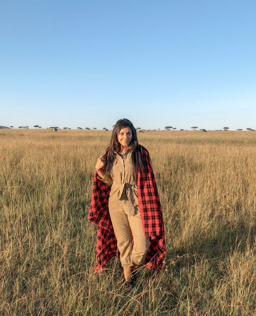 Bonnie Rakhit at Faitmont Masai mara in the traditional mara check blanket