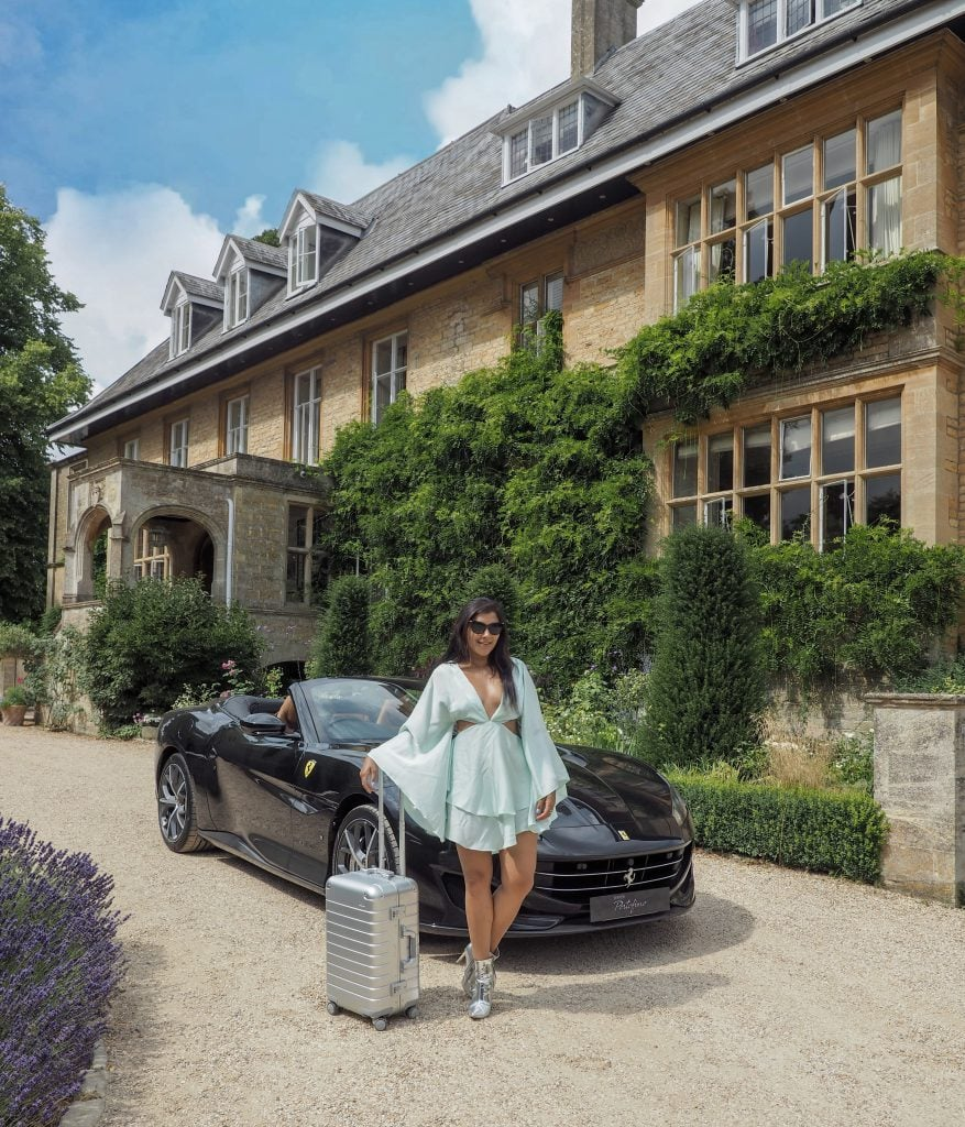 Ferrari sports cars girls weekend road trip Slaughter manor house lunch away luggage revolve dress