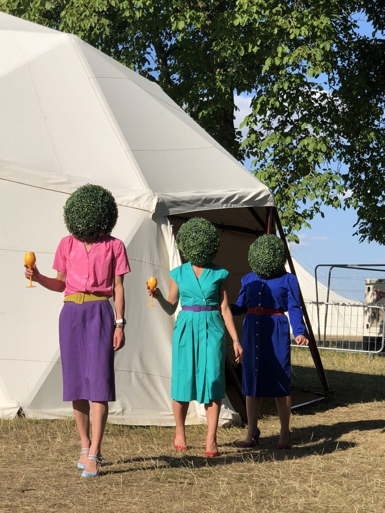 Veuve clicquot hedge head ladies at Wilderness Festival topiary gardening