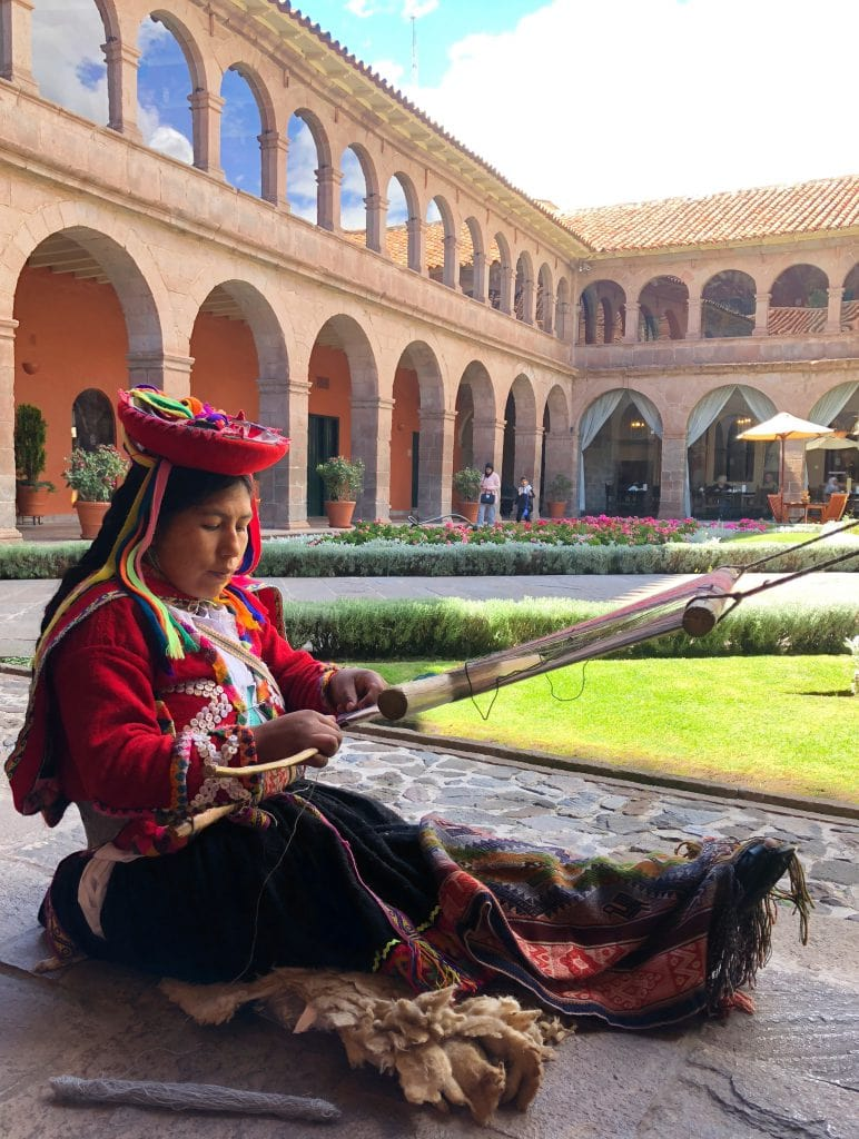 Belmond Monasterio best luxury hotels in Cusco Bonnie Rakhit traditional weaver in Peruvian costume