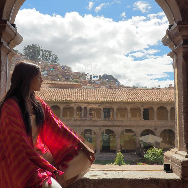 Belmond Monasterio best luxury hotels girl sat in archway with monastery view Bonnie Rakhit