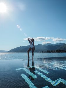 Bonnie Rakhit Style Traveller at Regent porto Montenegro luxury hotel beautiful infinity pool white asos swimsuit