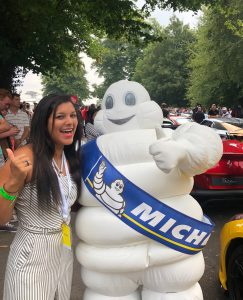 Bonnie Rakhit Goodwood festival of speed with Ferrari sports cars vip pass female racing Michellin man