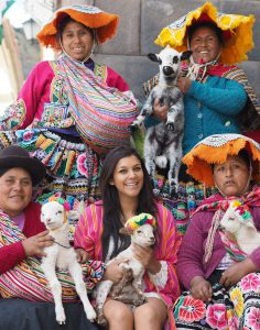 Belmond Monasterio best luxury hotels in Cusco Bonnie Rakhit Ladies in traditional Peruvian costume with lambs
