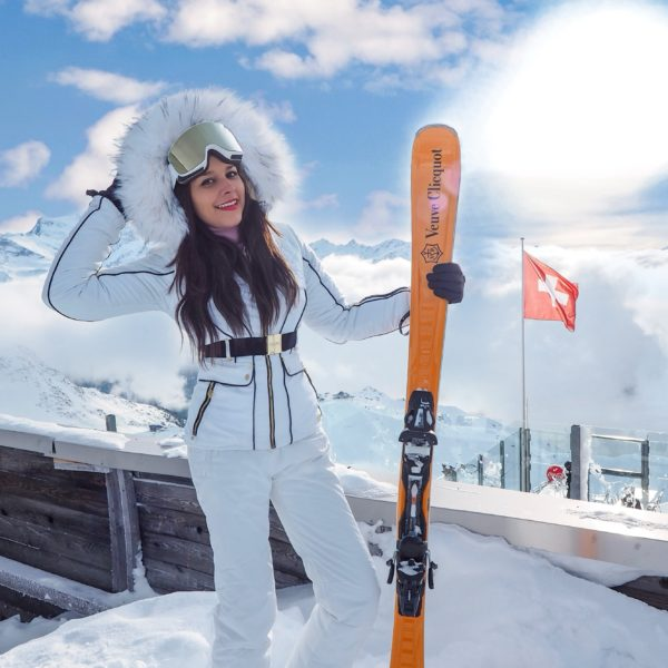 Verbier what to wear ski outfits The Alps Bonnie Rakhit wearing Julien MacDonald Dare2Be ski suit Veuve Cliquot skis