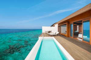 swimming pool deck at water villa westin maldives