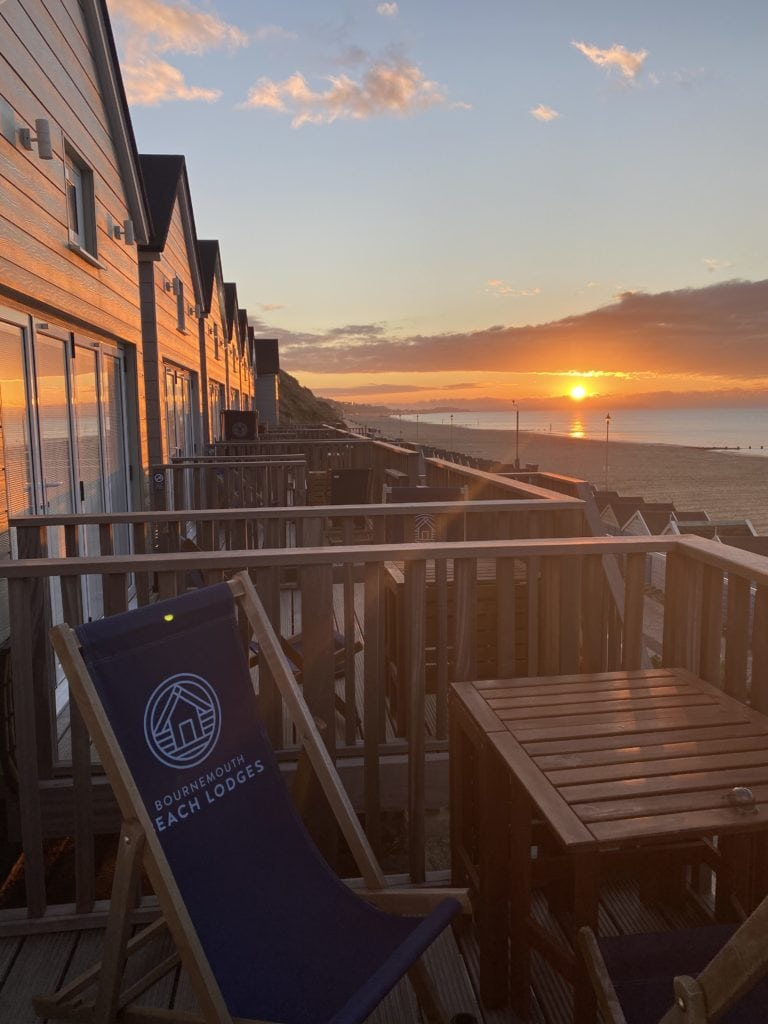 The Perfect UK Staycation Bournemouth beach lodges at sunset