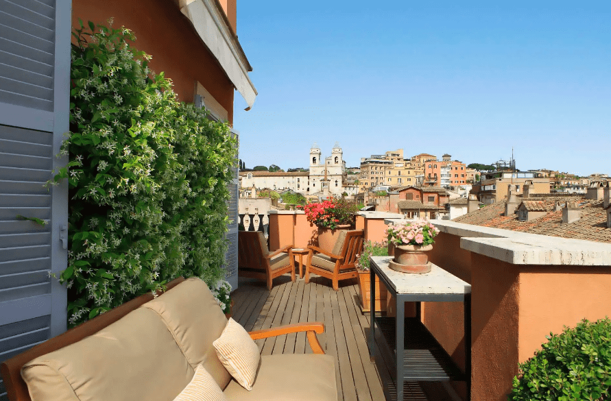 Living La Dolce Vita in Rome - Portrait Roma suite terrace by day with stunning views of Rome