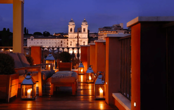 Rome's Most Stylish Italian Town House Hotel - Portrait Roma suite terrace at night